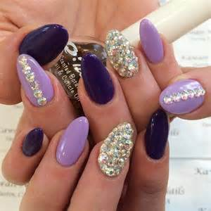 Purple and lavender nails with silver glitter rhinestones modern