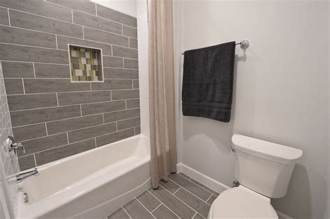 bathroom with daltile fabrique 6 x 24 unpolished field