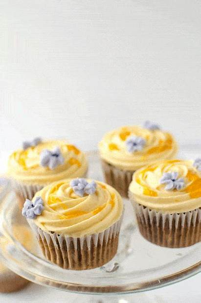 Banana Cupcakes Apricot Frosting Spiced Recipe Cross