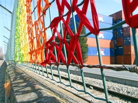 creative street art cross stitch murals  fences