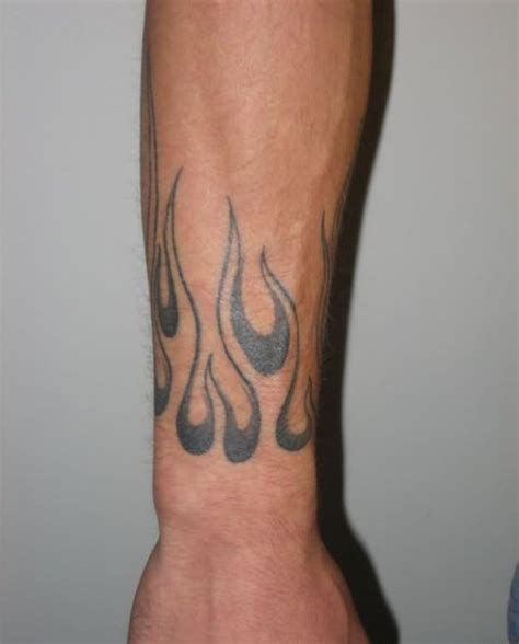 Picture Of Black flame tattoo on the wrist