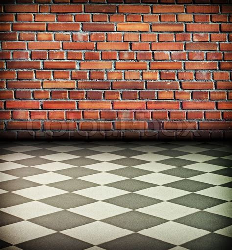 creative vintage interior with brick wall and chess tile