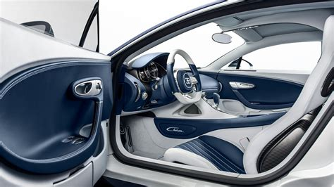 Fixed carbon fiber seats, no carper or insulation, and pull straps instead of door handles. Bugatti Chiron: Breaking new dimensions