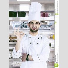 Arabian Chef With Ok Sign In The Kitchen Stock Photo