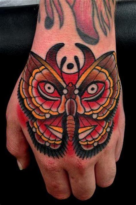 school hand moth tattoo  montalvo tattoos