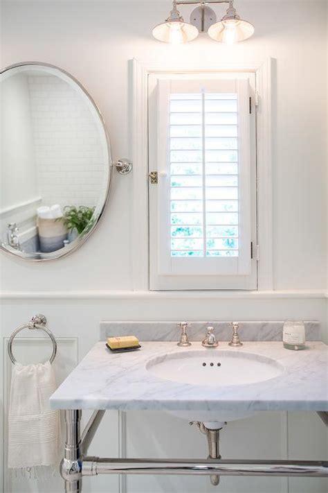 bathroom window dressed  plantation shutters  vanity
