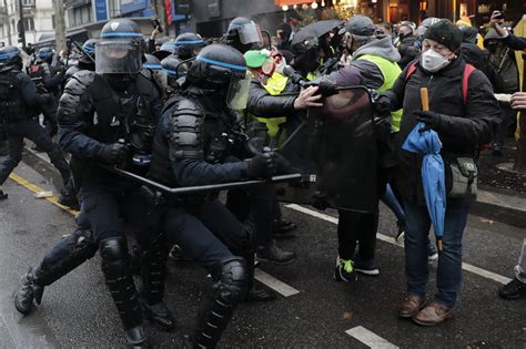 Nearly 150 arrested at Paris protest over security bill ...