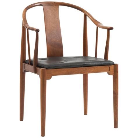 a pair of chairs in cuban mahogany by hans j