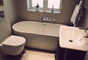 Stone Shower Surround by Free Standing Bath In Small Bathroom Bathroom Fitters