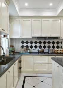 black and white tile kitchen ideas white kitchen cabinets black and white tile backdrop