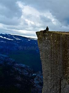 Man Sitting On Pulpit Rock Preikestolen Norway Stock Photo ...