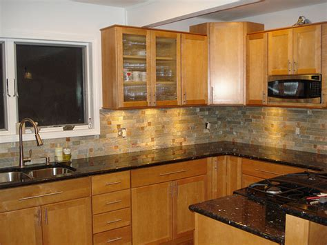 honey oak kitchen cabinets with granite countertops granite countertops and oak cabinets