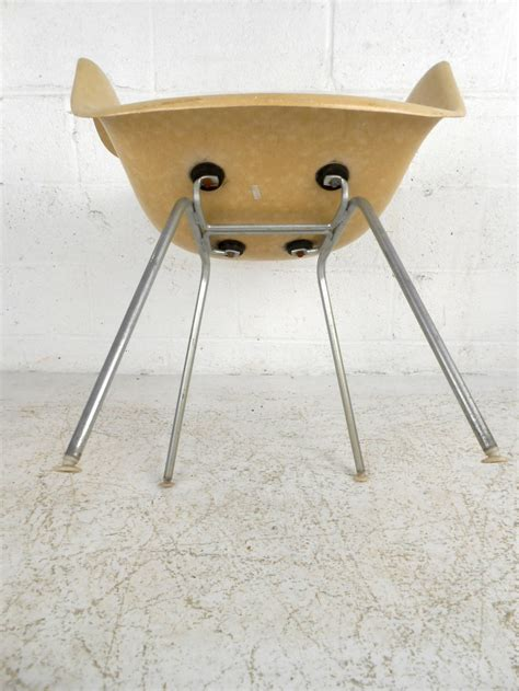 mid century modern fiberglass shell chair by eames for