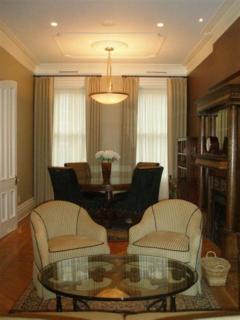 Warm Parlor And Sitting Area With Pendant Light And