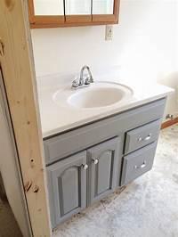 painting bathroom vanity Painted Bathroom Vanity - Michigan House Update - Liz ...