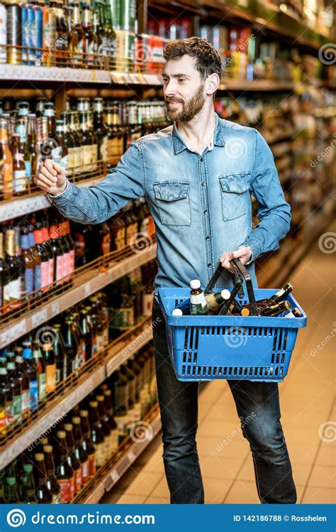 Man Buying Beer In The Supermarket Stock Photo - Image of ...