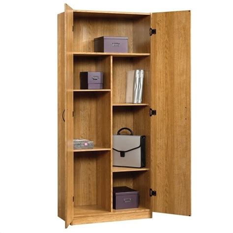 sauder oak storage cabinet sauder beginnings storage cabinet in highland oak 413326