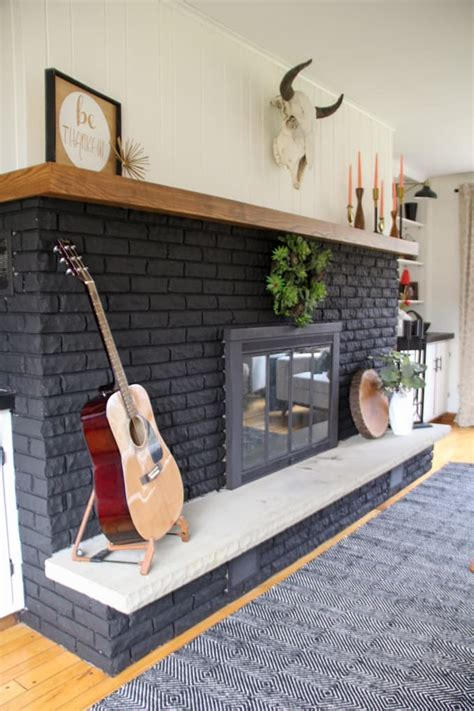our black painted fireplace bright green door