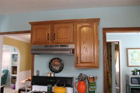 honey oak kitchen with light blue walls future house