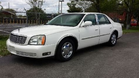 sell   cadillac deville  owner pearl white withtan interior chrome wheels  pompano