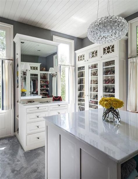 Gray Wardrobe Closet by White And Gray Closet Features Gray Walls Lined With Glass