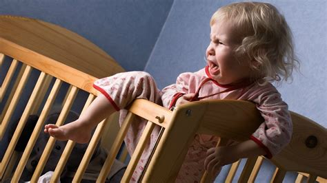 baby climbing out of crib this could be why your aren t sleeping komando