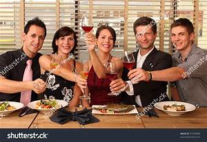 Friends In A Restaurant - Cheers Clink Glasses -Food Stock ...