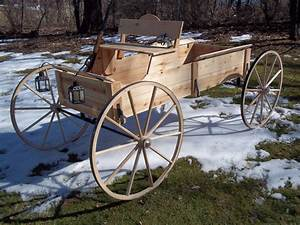"Cedar buckboard wagon with 32""hickory wagon wheels by www"
