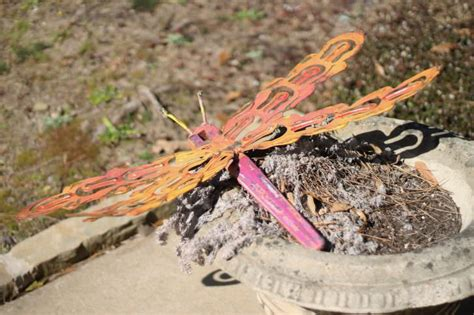 whimsical dragonfly wall art outdoor sculpture