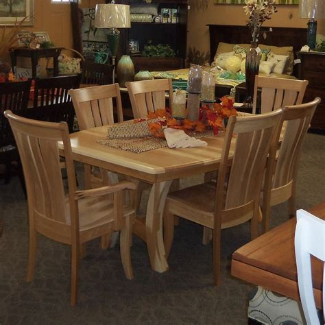 Grand Island dining table, shown in Hickory with a natural