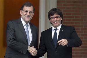 Spain PM holds first talks with Catalan pro-secession ...