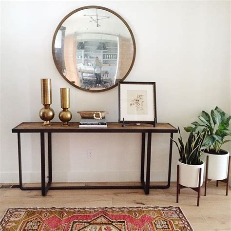 Round Convex Mirror Over Console Table Entryways