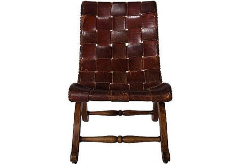 woven leather sling back chair