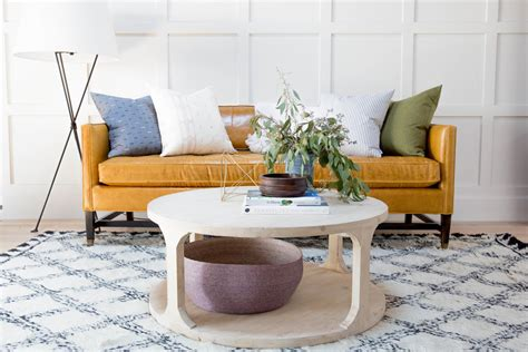 Choosing the right coffee table to go with your sectional sofa can be tricky! How to Style a Round Coffee Table - Studio McGee