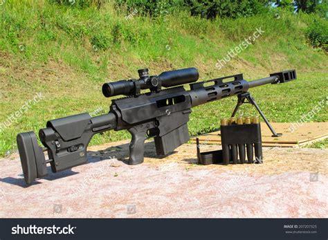 50 Bmg Range sniper rifle 50 bmg caliber riflescope stock photo