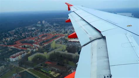 wing berlin easyjet landing at berlin tegel airport txl easyjet airbus a320 wing view landing at berlin