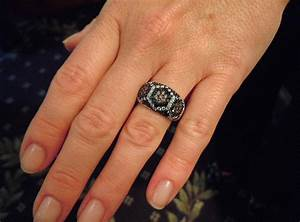 wearing wedding ring on right hand with black diamond With wearing wedding rings