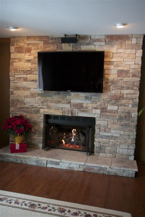 ledge stone fireplace  tv located  lake zurich