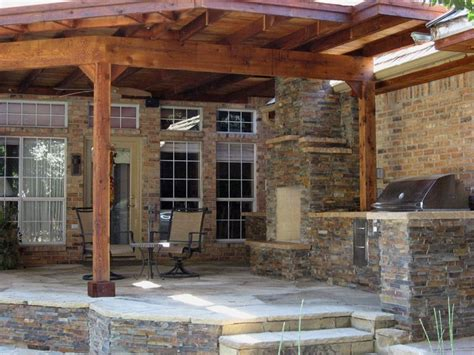 elevated patio with covered fireplace and built in grill