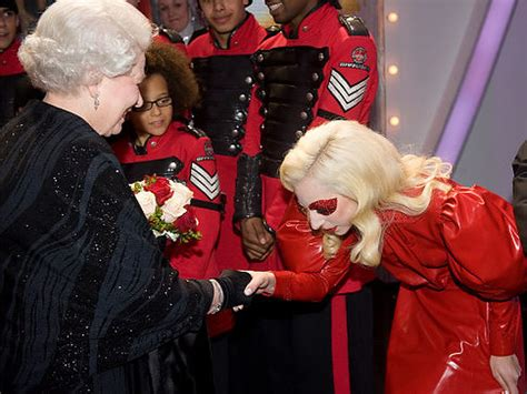 lady gaga meets queen elizabeth ii  england  dresses