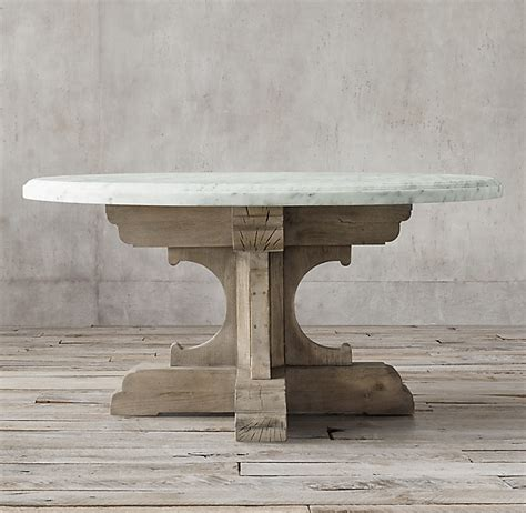 Clad in marble, a tracery of natural veining lends each table unique character, while a low, inset base makes this monumental piece appear to float. 17th C. French Bastide Oak & Marble Round Dining Table
