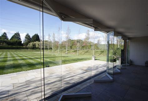 nearly frameless sliding folding doors to garden