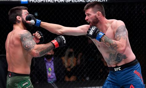 UFC 255: Tim Means batters Mike Perry en route to decision ...