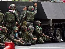 Armored vehicle repeatedly rams into protest zone ...