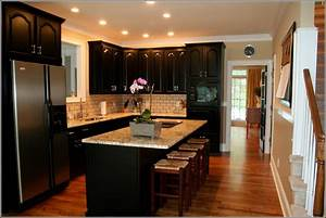 Kitchen With White Cabinets And Black Appliances Home