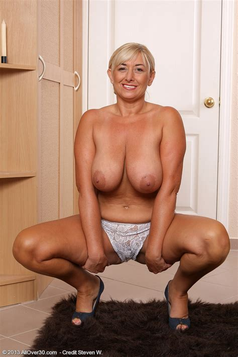 Elegant And Busty Melyssa Spreading Her Meaty Mature Legs Here Mel