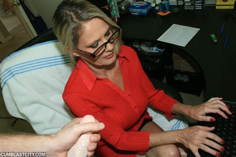 Fully Clothed Mature Blonde In Glasses Gives A Handjob And