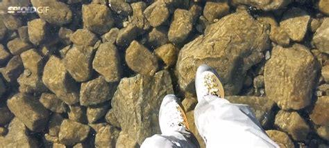 walking   transparent frozen lake feels  walking