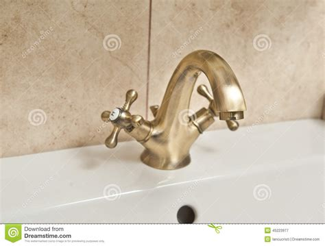 chrome dripping tap sink faucet in bathroom water saving