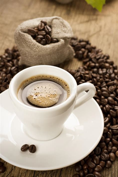Keep up to speed on our newest coffees, upcoming tastings, and other small planes updates! Small Cup Of Black Coffee With Coffee Beans Stock Photos ...
